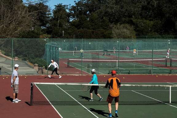 People occupy multiple courts for both lessons and leisure at the Golden Gate Park Tennis Center Tuesday, Feb. 6, 2018 in San Francisco, Calif.