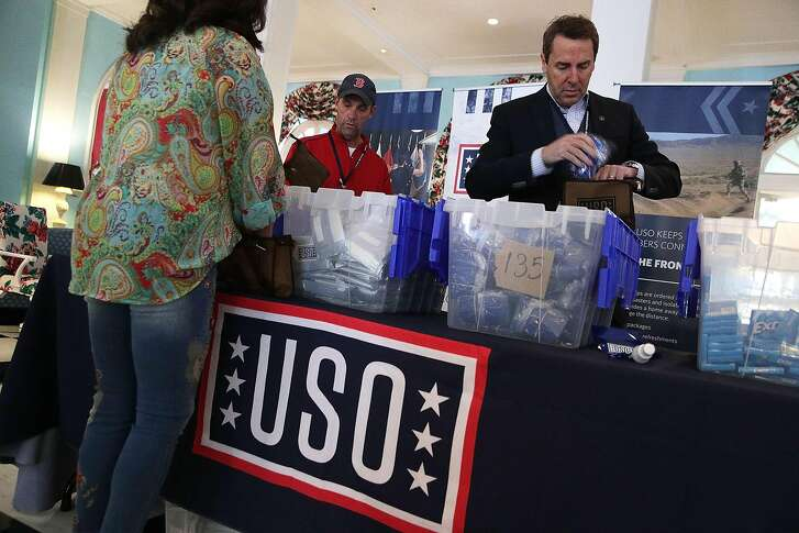 WHITE SULPHUR SPRINGS, WV - FEBRUARY 02:  Rep. Mark Walker (R-NC) (R) and Rep. Steve Knight (R-CA) (2nd R) prepare care packages for USO during the 2018 House & Senate Republican Member Conference February 2, 2018 at the Greenbrier resort in White Sulphur Springs, West Virginia. Congressional Republicans wrap up the last day of their annual retreat at the Greenbrier where they discuss legislative agenda for the year. (Photo by Alex Wong/Getty Images)