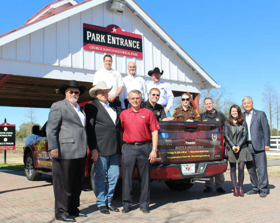 Major sponsors are preparing for the annual Boots and Badges Gala, scheduled for Feb. 10 at the George Ranch Historical Park.From bottom left are Nick Landoski, John Norsworthy, Ron Ewer with Legacy Ford, Mark Flathouse, Rand Wall, Rocky Parr, Daniel Quam, Angel Rader, Ben Simpson, and Monica Coimbra and Allison Wen with Safari Texas. Photo: Behind The Badges Charity