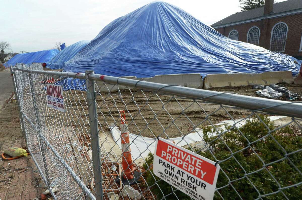 Mounds of backfill are covered with tarps at the former Loehmann's construction site at 467 West Ave. Tuesday, February 6, 2018, in Norwalk, Conn. The Norwalk Common Council?'s Planning Committee resumed its discussion of a proposed Wall Street-West Avenue Innovation District this month. For about a year, the committee has been studying whether to extend tax incentives, carte blanche or across the board, northward from South Norwalk up West Avenue to Wall Street.
