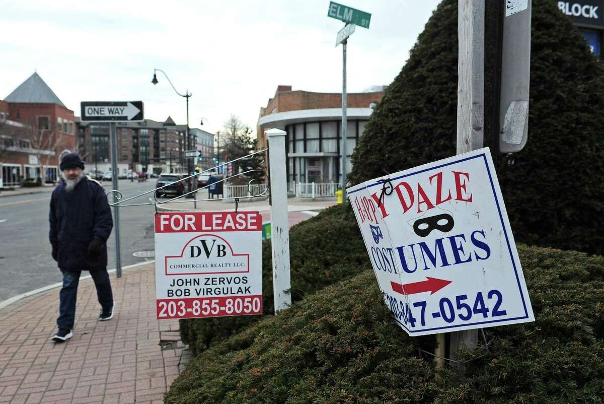 An pedestrian walks by a leasing sign along West Ave. Tuesday, February 6, 2018, in Norwalk, Conn. The Norwalk Common Council?'s Planning Committee resumed its discussion of a proposed Wall Street-West Avenue Innovation District this month. For about a year, the committee has been studying whether to extend tax incentives, carte blanche or across the board, northward from South Norwalk up West Avenue to Wall Street.