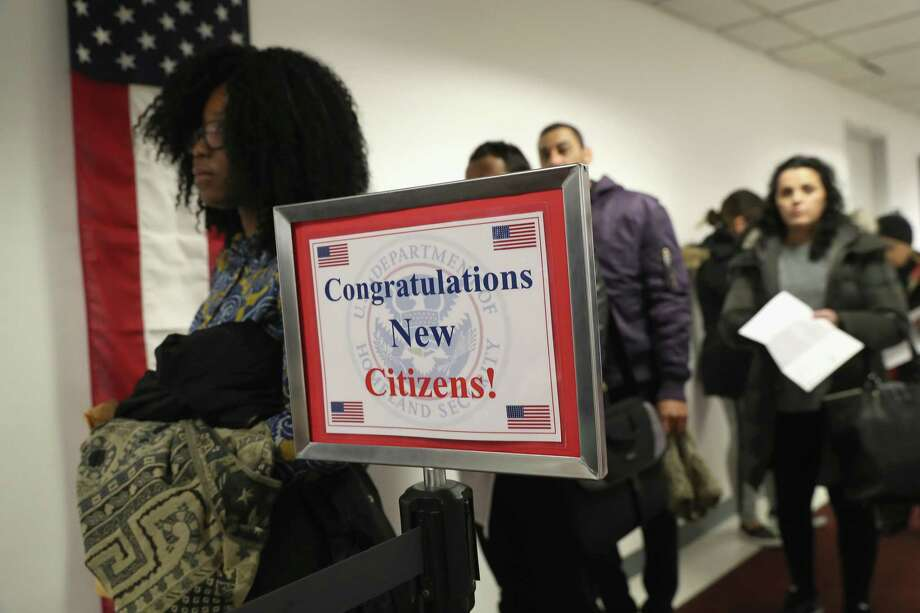 Immigrants wait in line to become U.S. citizens at a naturalization ceremony on Feb. 2 in New York City. Contrary to President Donald Trump's positions, America needs immigrants. Photo: John Moore /Getty Images / 2018 Getty Images