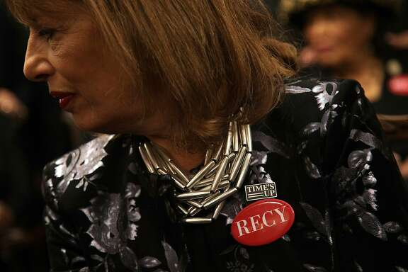 "WASHINGTON, DC - JANUARY 30:  U.S. Rep. Jackie Speier (D-CA) wears black with a ""Time's Up"" pin and a ""RECY"" button as she participates in a photo-op at the U.S. Capitol prior to President Donald Trump's first State of the Union address January 30, 2018 in Washington, DC. House Democrats plan to show up in black when attending the State of the Union address this evening in support the #MeToo and #TimesUp movements. The RECY button refers to Recy Taylor, a black woman who was kidnapped and raped by six white men in Alabama in 1944. (Photo by Alex Wong/Getty Images)"