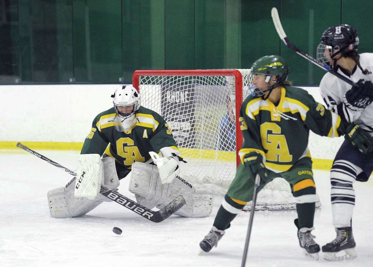 Courtney DeNaut, left, has played Greenwich Academy since she was an eighth-grader and has established herself as one of the premier goaltenders in the NEPSAC