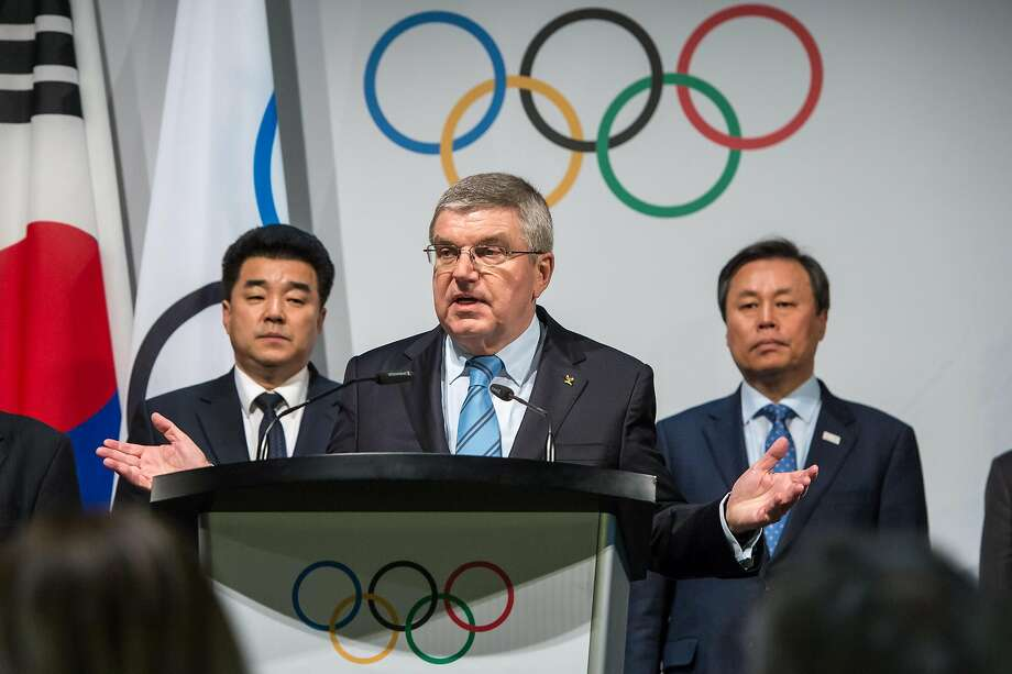 PULLY, SWITZERLAND - JANUARY 20: IOC President Thomas Bach gives a speech, behind him representatives of both countries on left Mr. Il Guk Kim, Sport Minister and President of the Olympic Committee of the Democratic People's Republic of Korea, on right Mr. Jong Whan Do, South Korea, Minister of Culture, Sports and Tourism on January 20, 2018 in Pully, Switzerland. It was announced that North Korea intends to send 22 athletes to compete in three sports including skating, skiing and in a unified North and South Korean women's ice hockey team, and that the two nations would march together at the opening ceremony at the upcoming Winter Olympics in Pyeongchang, South Korea next month. (Photo by Robert Hradil/Getty Images) Photo: Robert Hradil, Getty Images