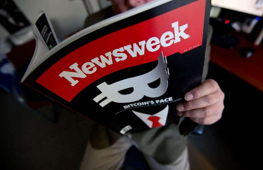 "(FILES) In this file photo illustration taken on March 10, 2014 shows a man reading a copy of Newsweek magazine in Washington. The news media group Newsweek was in turmoil this week amid the firing of its top editorial staff, reportedly for investigating the finances of their own company. Veteran reporter Matthew Cooper announced his resignation late February 5, 2018, saying the firing of top Newsweek editors was a ""disgrace"" and a sign of ""reckless leadership"" at the New York media group with the brand of the onetime leading news magazine.  / AFP PHOTO / Nicholas KAMMNICHOLAS KAMM/AFP/Getty Images Photo: NICHOLAS KAMM, AFP/Getty Images"