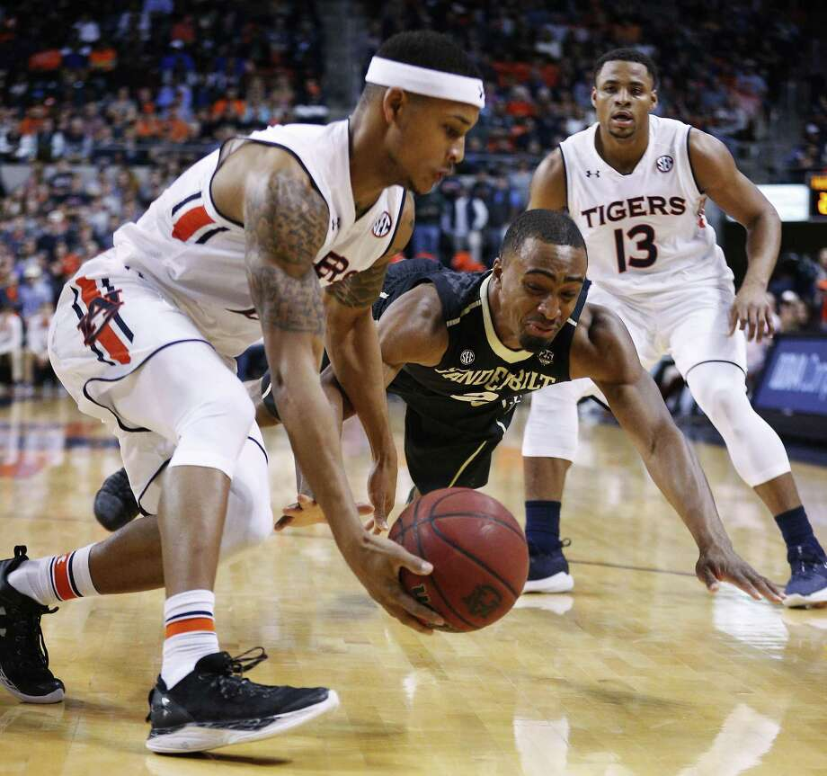 Auburn guard Bryce Brown, left, and Vanderbilt guard Joe Toye dive for a loose ball during the first half of an NCAA college basketball game Saturday, Feb. 3, 2018, in Auburn, Ala. (AP Photo/Brynn Anderson) Photo: Brynn Anderson, STF / Associated Press / Copyright 2018 The Associated Press. All rights reserved.
