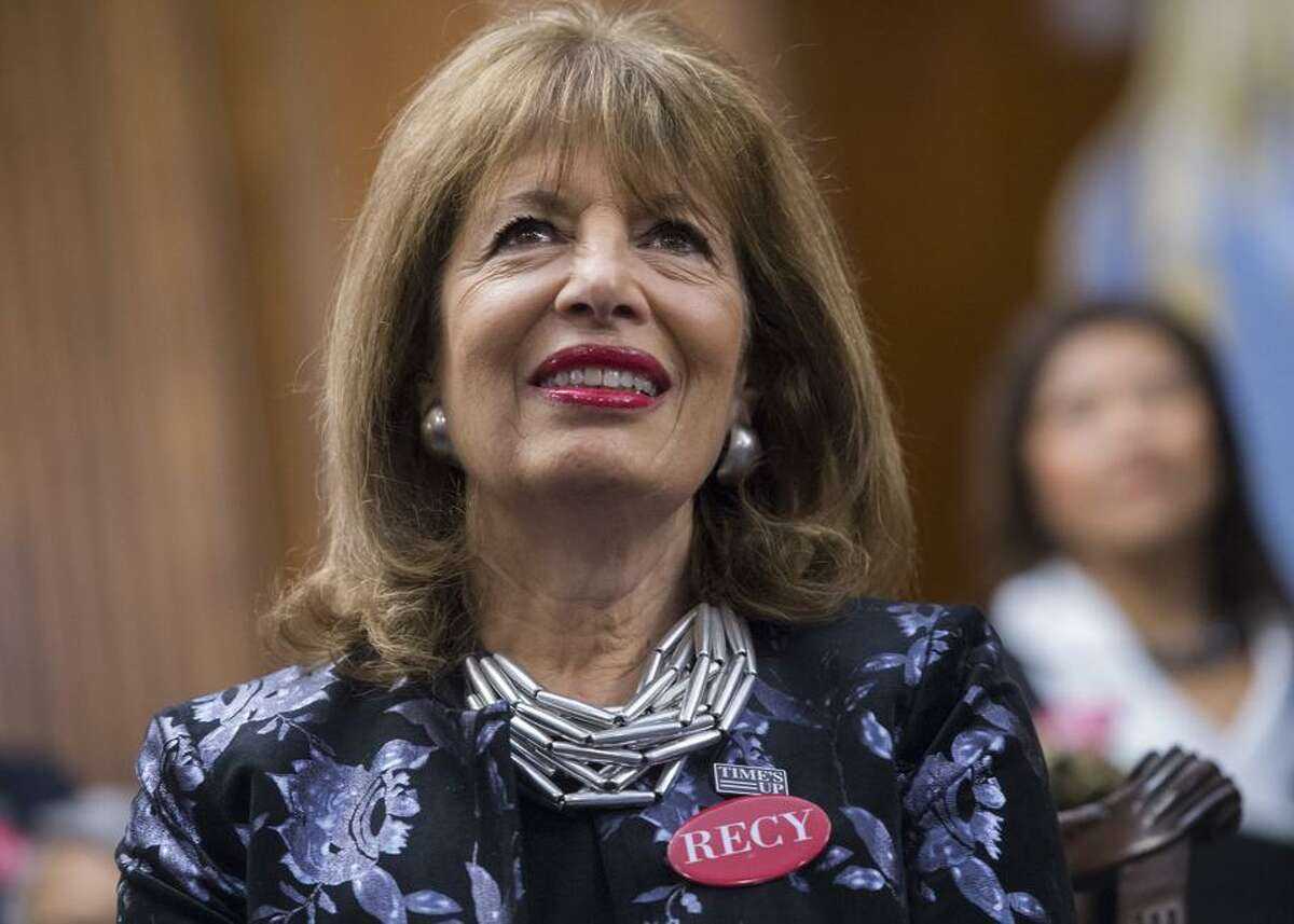Rep. Jackie Speier, D-Calif., wears a pin featuring the name of sexual assault survivor Recy Taylor, during a photo op in the Capitol's Rayburn Room to show solidarity with men and women who are speaking out against sexual harassment and discrimination.
