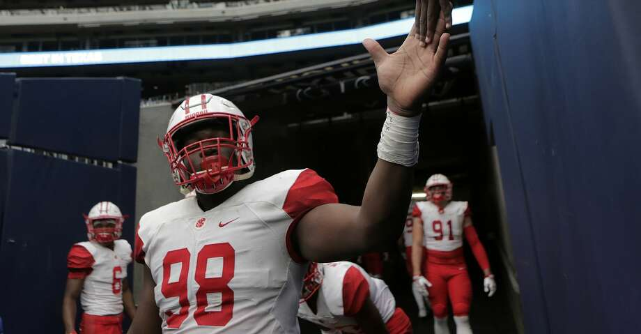 Katy defensive tackle Moro Ojomo committed to Texas ahead of Wednesday's National Signing Day. Photo: Elizabeth Conley/Houston Chronicle