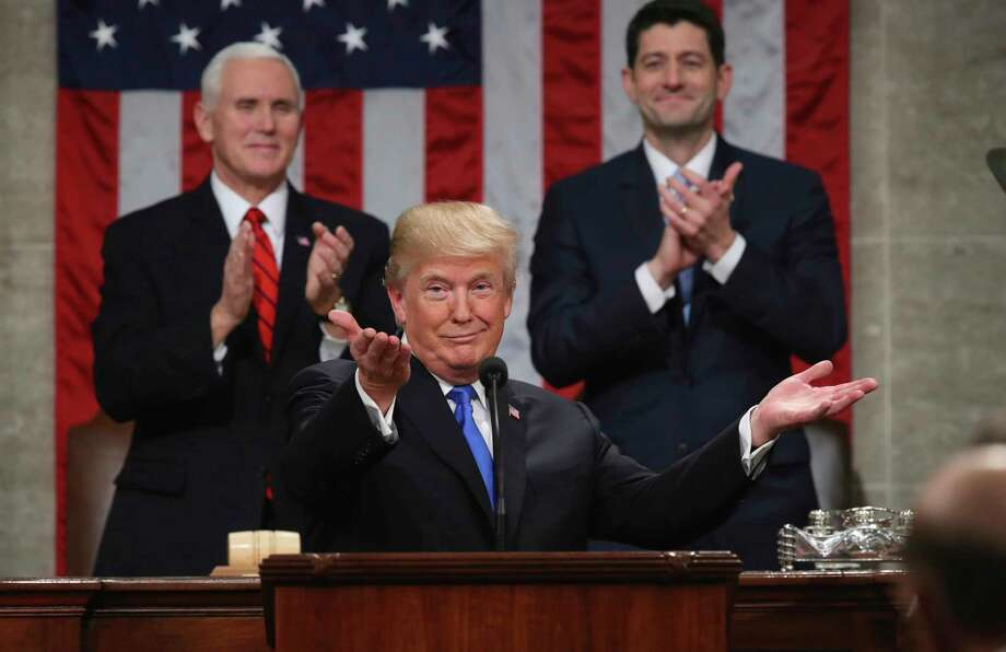 """FILE - In this Jan. 30, 2018, file photo, President Donald Trump gestures as delivers his first State of the Union address in the House chamber of the U.S. Capitol to a joint session of Congress in Washington, as Vice President Mike Pence and House Speaker Paul Ryan applaud. Less than a week ago, Trump stood before the nation and called for a new era of bipartisan cooperation. """"Tonight, I call upon all of us to set aside our differences, to seek out common ground, and to summon the unity we need to deliver for the people we were elected to serve,"""" he said, extolling how the country had come together in recent times of tragedy. A week later, such talk is but a distant memory. (Win McNamee/Pool via AP, File) Photo: Win McNamee, POOL / 2018 Getty Images"""
