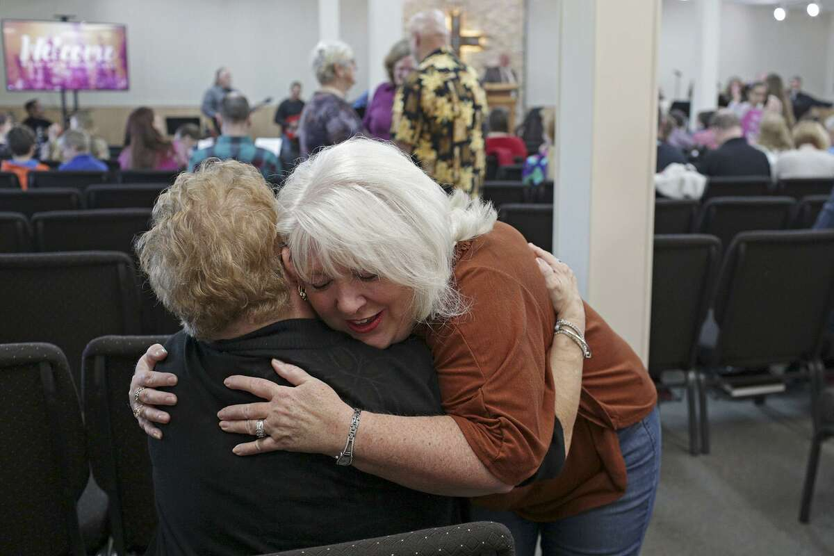 Michelle Shields embraces a friend during the Sunday service at First Baptist Church of Sutherland Springs on February 4, 2018.