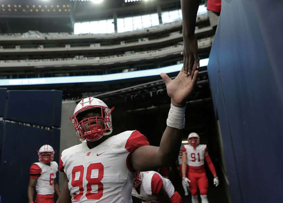 Katy's Moro Ojomo prepares to take the field for a playoff game at NRG  Stadium.