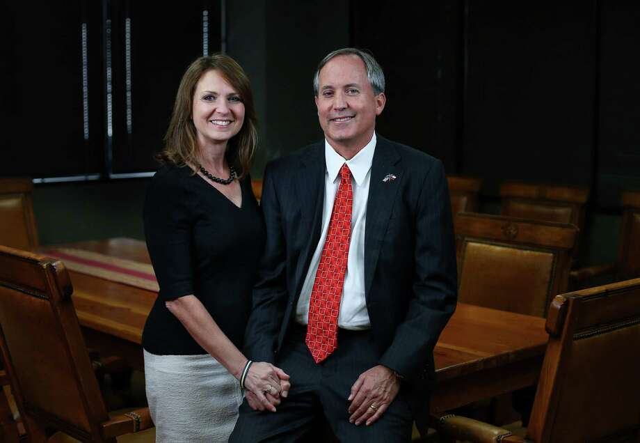 Texas Attorney General Ken Paxton, and his wife, Angela Paxton, pose for a portrait. Attorney General Ken Paxton's political campaign guaranteed a $2 million loan to help his wife fuel her bid for a state Senate seat in North Texas. Photo: Houston Chronicle File Photo / © 2015  Houston Chronicle