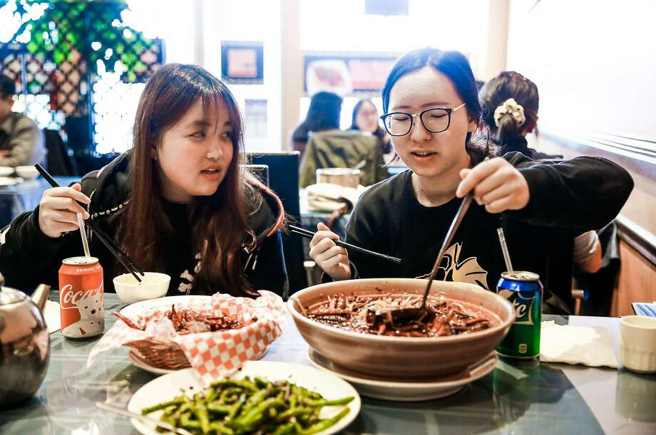 Skylar Li (left) and Vicky Liu dine at Chef Zhao Bistro in San Mateo. Photo: Gabrielle Lurie, The Chronicle