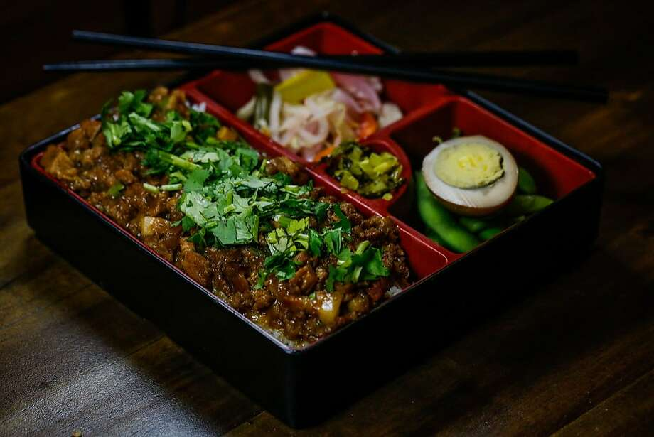 Rice with ground pork in a bento box with half a boiled egg and pickled vegetables at Taiwan Bento in Oakland. Photo: Gabrielle Lurie, The Chronicle