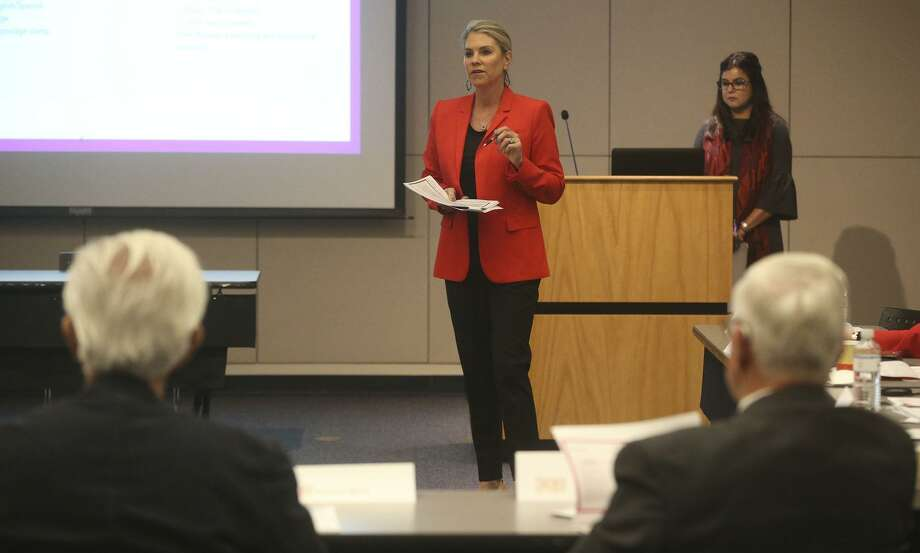 Katie Harvey (center) of KGB Texas Communications speaks Tuesday February 6, 2018 to the Tricentennial Commission at the downtown central public library. The commission is expected to vote to amend their contract with KGB reducing monthly payments to the local marketing company. Photo: John Davenport, STAFF / San Antonio Express-News / ©John Davenport/San Antonio Express-News