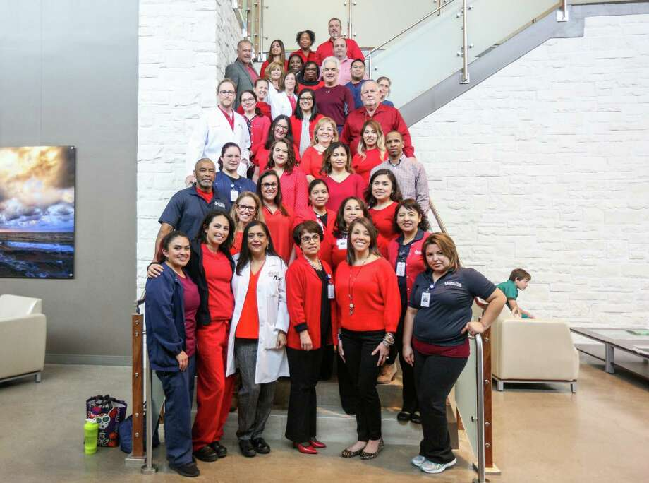 Staff of Lone Star Family Health Center dress in red as they advocate for overdue funding on Tuesday, Feb. 6, 2018, at Lone Star Family Health Center in Conroe. Photo: Michael Minasi, Staff Photographer / © 2017 Houston Chronicle