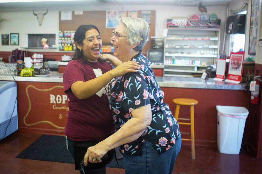 "Maria Silva (left), who has worked at the restaurant for nine years, hugs regular customer Deloris Matej during the first lunch service since Harvey-related flooding closed down Roper's Country Store and Cafe, Tuesday, Feb. 6, 2018, in Simonton. Deloris and her husband Frank were missing the restaurant which they used to come to several times a week since it opened. ""This has been our go to place ... forever,"" said Matej. ""It's either a sandwich at home or it's Ropers."" Photo: Mark Mulligan, Houston Chronicle / © 2018 Houston Chronicle"