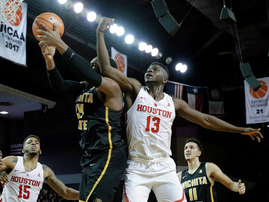 Nura Zanna, right, leads UH in fouls with 67 but is hardly alone among the big men in battling to stay on the floor. Photo: Michael Wyke, Freelance / © 2017 Houston Chronicle
