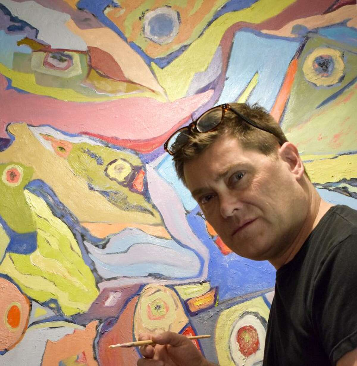 Artist Paul Gobell works on his painting,
