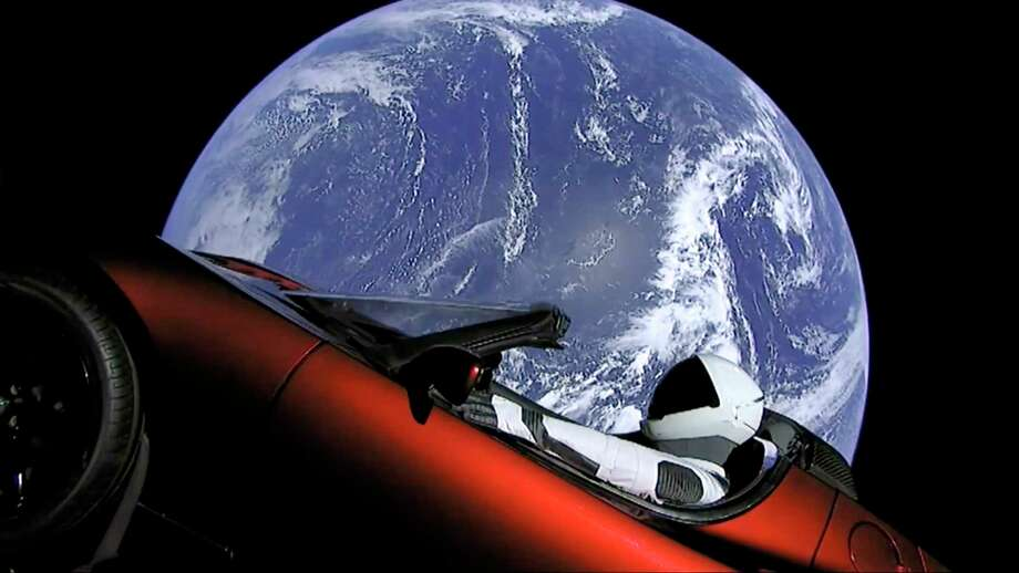 This image from video provided by SpaceX shows the company's spacesuit in Elon Musk's red Tesla sports car which was launched into space during the first test flight of the Falcon Heavy rocket on Tuesday, Feb. 6, 2018. (SpaceX via AP) Photo: HONS / SpaceX