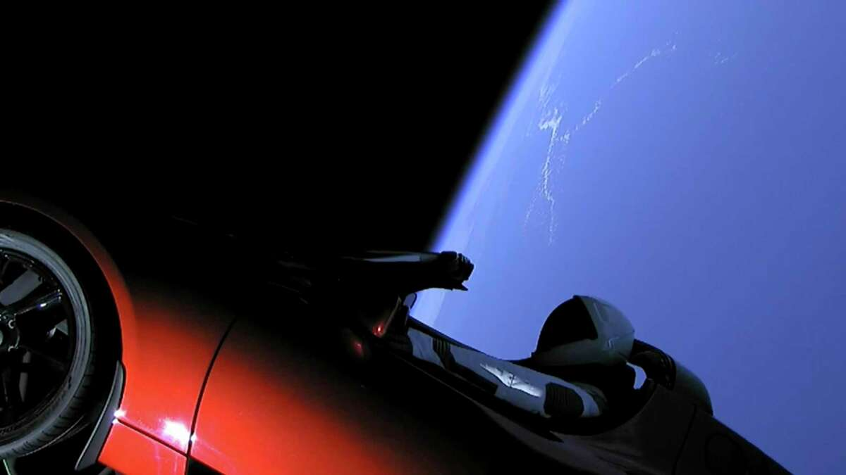 """SpaceX's """"Starman"""" heads to the heavens in Elon Musk's Tesla sports car, which was launched during the first test flight of the $90 million Falcon Heavy rocket."""
