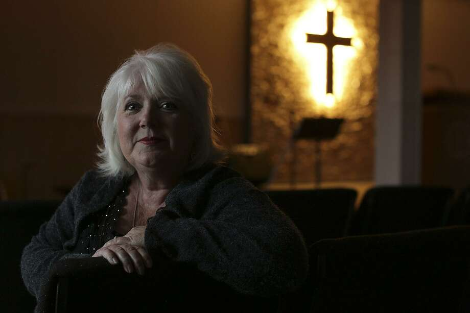 Wearing her mother's sweater, Michelle Shields sits in the new temporary sanctuary for First Baptist Church of Sutherland Springs, where she has been a member since 2004, on Tuesday, Feb. 6, 2018. Shields' mother was killed in the massacre at the church Nov. 5. Photo: Lisa Krantz / SAN ANTONIO EXPRESS-NEWS / SAN ANTONIO EXPRESS-NEWS
