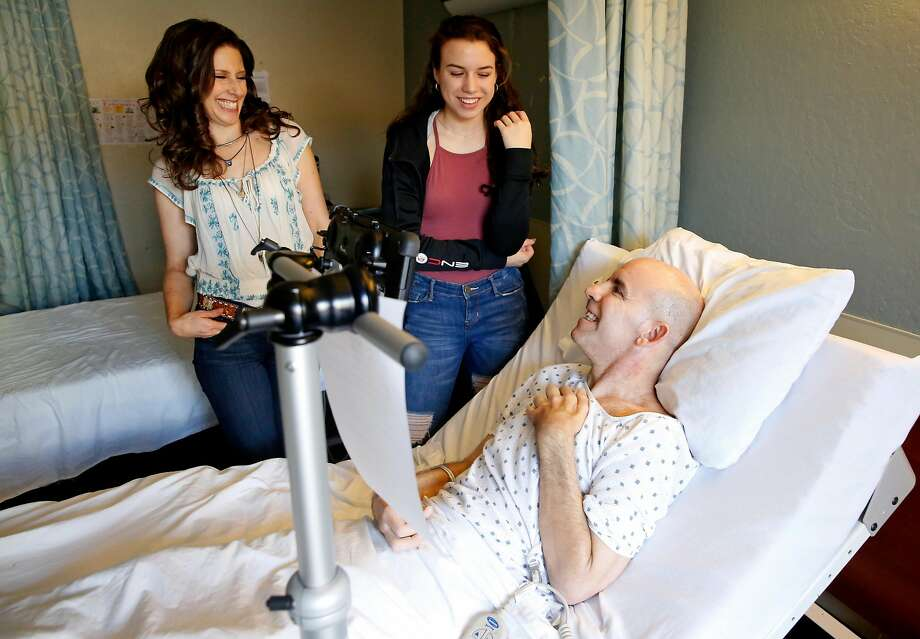 Bernie Dalton, who has been diagnosed with bulbar-onset ALS, shares a laugh with with his daughter Nicole, 16, and voice coach Essence Goldman during a portrait session at Cupertino Healthcare & Wellness. Photo: Guy Wathen, The Chronicle