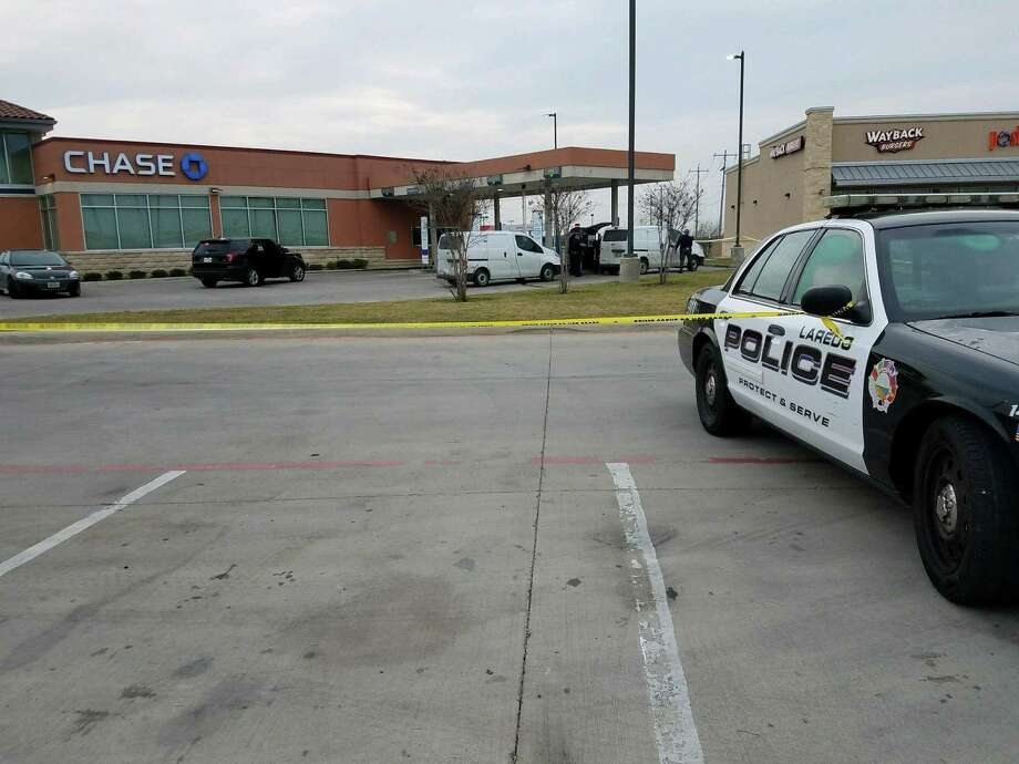 Laredo police secured the scene of an alleged robbery reported at a Chase Bank ATM by Bob Bullock Loop and International Boulevard. Photo: Courtesy Photo /Laredo Police Department