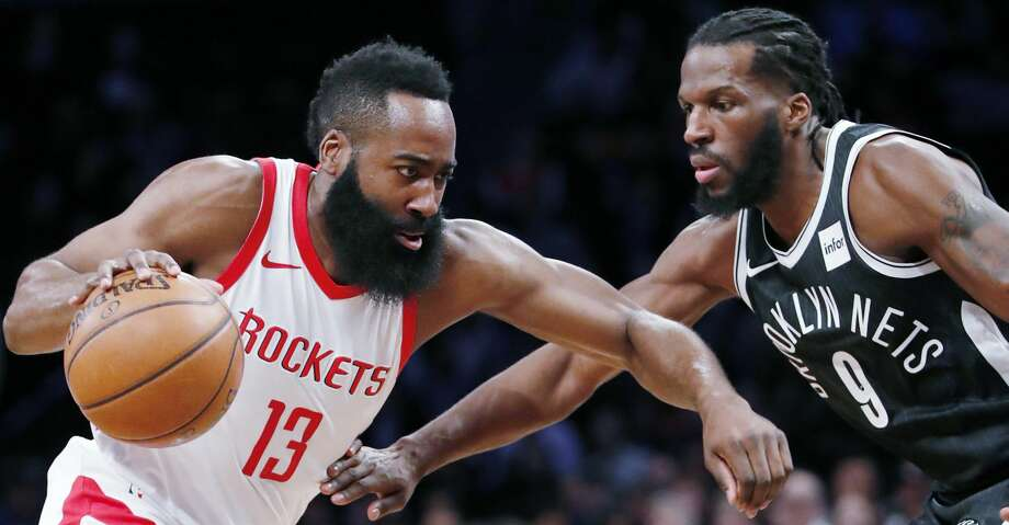 Houston Rockets guard James Harden (13) drives toward the basket as Brooklyn Nets forward DeMarre Carroll (9) defends during the first half of an NBA basketball game, Tuesday, Feb. 6, 2018, in New York. (AP Photo/Kathy Willens) Photo: Kathy Willens/Associated Press