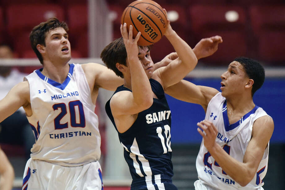 Midland Christian's Silas Crews (20) and Joseph Venzant (24) cover Fort Worth All Saints Mason Suitt (10) on Feb. 6, 2018, at McGraw Events Center. James Durbin/Reporter-Telegram Photo: James Durbin