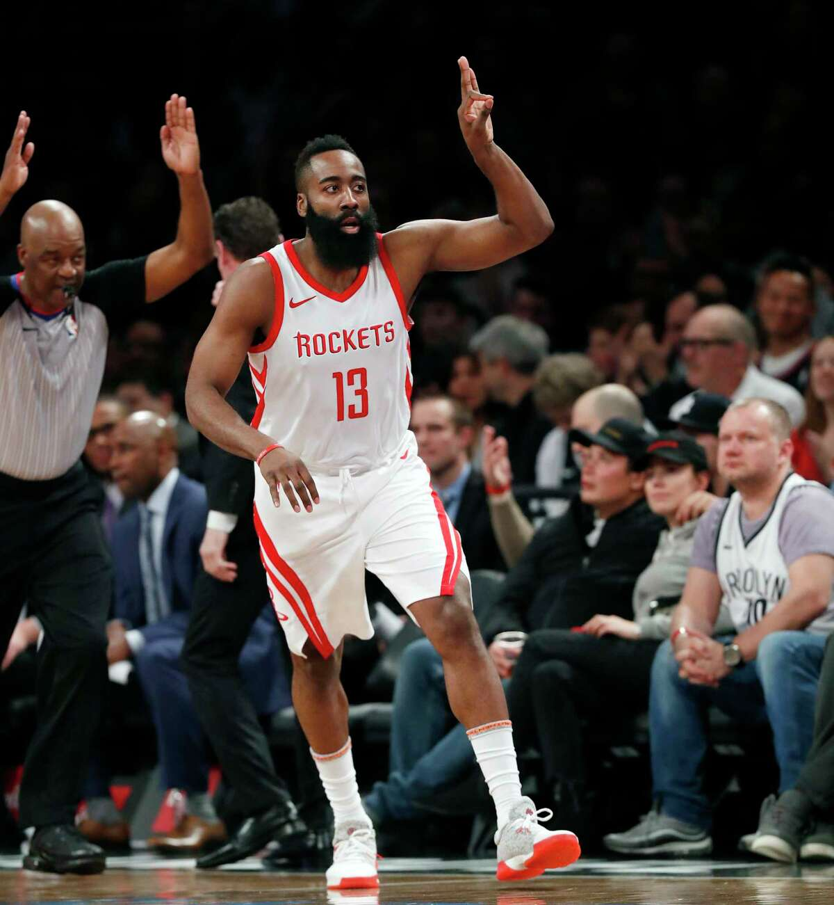James Harden signals a 3-pointer, one of four the Rockets star hit Tuesday on his way to 36 points.
