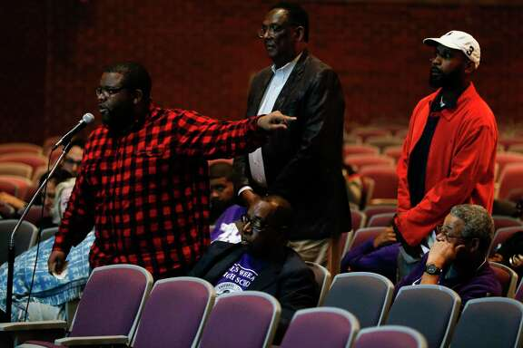 Community members speak during a community meeting at Wheatly High School where Houston ISD administrators discuss surrendering control over hiring, curriculum and governance at eight schools, including Wheatley Tuesday, Feb. 6, 2018 in Houston. The measures are being proposed to prevent the state from taking over HISD's school board.
