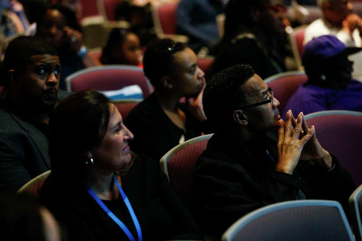 Jeffery Latson, right, listens to speakers during a community meeting at Wheatly High School where Houston ISD administrators discuss surrendering control over hiring, curriculum and governance at eight schools, including Wheatley Tuesday, Feb. 6, 2018 in Houston. The measures are being proposed to prevent the state from taking over HISD's school board.