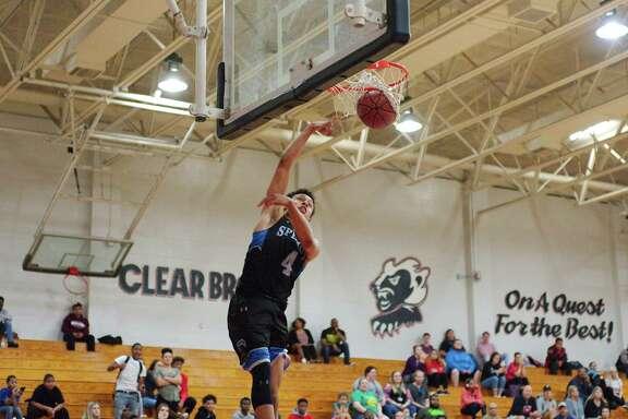 Clear Springs' Faite Williams (4) slams hone a dunk against Clear Brook Tuesday, Feb. 6 at Clear Brook High School.