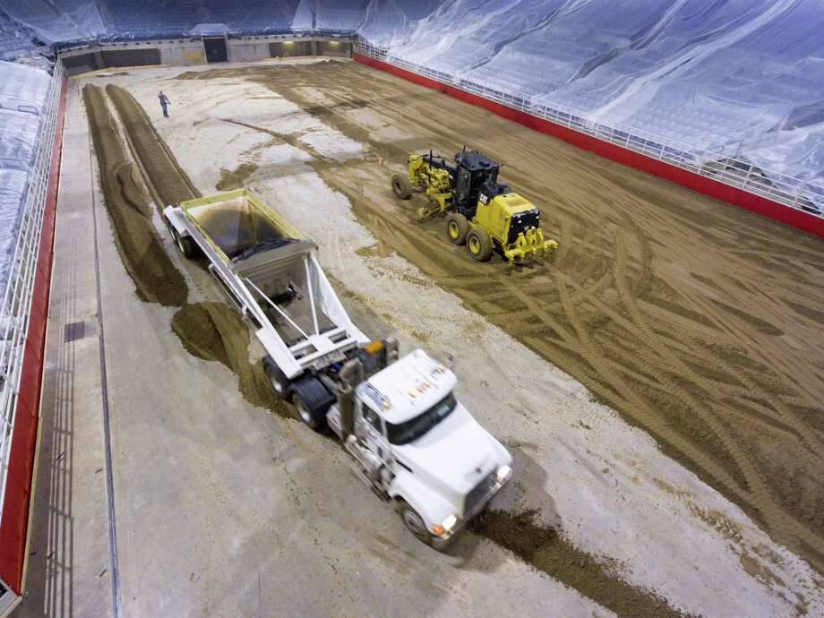 Dirt for the San Antonio rodeo is trucked Monday, Feb. 5, 2018 into the AT&T Center in advance of Thursday's opening night. Photo: William Luther, Staff / San Antonio Express-News / © 2018 San Antonio Express-News