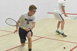 Will Mackle, a resident of New Canaan, left, helped lead the Greens Farms Academy boys squash team to a third-place finish at the US National High School championships over the weekend in Philadelphia.