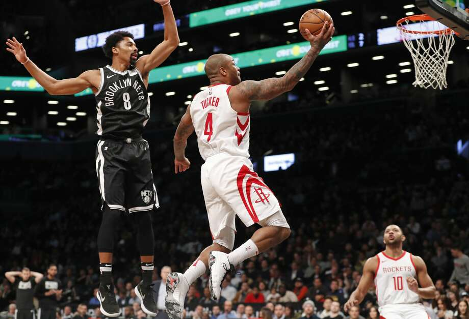 Houston Rockets forward PJ Tucker (4) goes airborne in front of Brooklyn Nets guard Spencer Dinwiddie (8) during the first half of an NBA basketball game, Tuesday, Feb. 6, 2018, in New York. Houston Rockets guard Eric Gordon (10) watches from the floor. (AP Photo/Kathy Willens) Photo: Kathy Willens/Associated Press