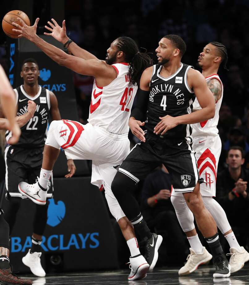 Houston Rockets center Nene Hilario (42) grabs a rebound i front of Brooklyn Nets center Jahlil Okafor (4) with Nets guard Caris LeVert (22) and the Rockets' Gerald Green, right, watching during the first half of an NBA basketball game, Tuesday, Feb. 6, 2018, in New York. (AP Photo/Kathy Willens) Photo: Kathy Willens/Associated Press