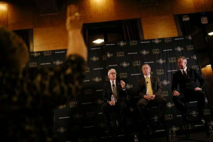 John Cox speaks as a clock moderator raises her hand in time during City Summit of Republican Candidates for Governor's Formal Discussion at the City Club of San Francisco in San Francisco, Calif. Tuesday, Feb. 6, 2018.