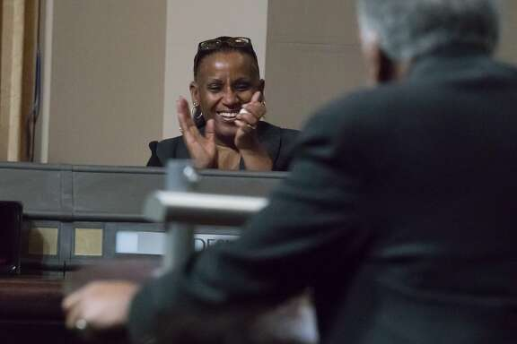 Councilwoman Desley Brooks applauds citizen James Vann who is against a rule change to give council President Larry Reid the authority to make committee assignment changes at will on Tuesday, Feb. 6, 2018 in Oakland, CA.