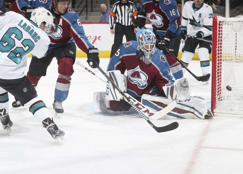A shot by Kevin Labanc (62) of the Sharks goes wide of Avalanche goaltender Jonathan Bernier, who stopped 39 shots in Colorado's 3-1 win over San Jose. Photo: Michael Martin / Michael Martin / NHLI Via Getty Images / 2018 NHLI