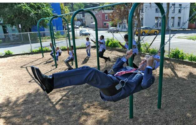 Joseph L. Bruno, the former Senate majority leader, checks out the new swings at a playground he helped to secure for School 12 in Troy. Pretrial moves continue in the criminal case against him in federal court in Albany. ( Skip Dickstein / Times Union ) Photo: Skip Dickstein / 2008