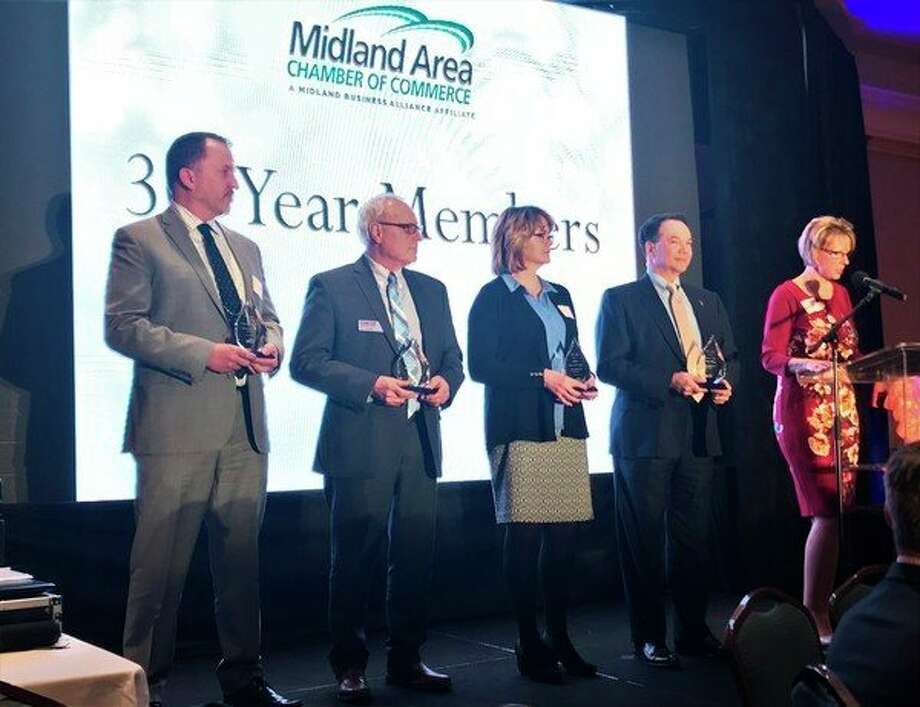 Thirty-year members of the Midland Area Chamber of Commerce were recognized during the chamber's annual meeting Tuesday, Feb. 6 at the Great Hall Banquet & Convention Center. (Kate Carlson/kcarlson@mdn.net)