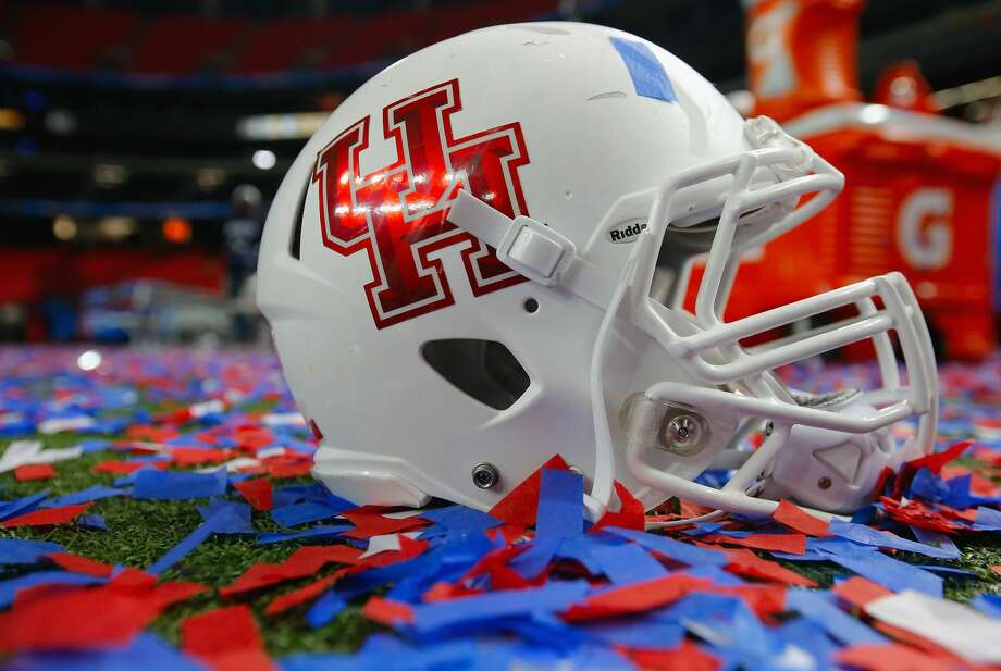 ATLANTA, GA - DECEMBER 31:  A Houston Cougars helmet is surrounded by confetti after the Cougars defeated the Florida State Seminoles 38-24 to win the Chick-fil-A Peach Bowl at the Georgia Dome on December 31, 2015 in Atlanta, Georgia.  (Photo by Kevin C. Cox/Getty Images) Photo: Kevin C. Cox/Getty Images