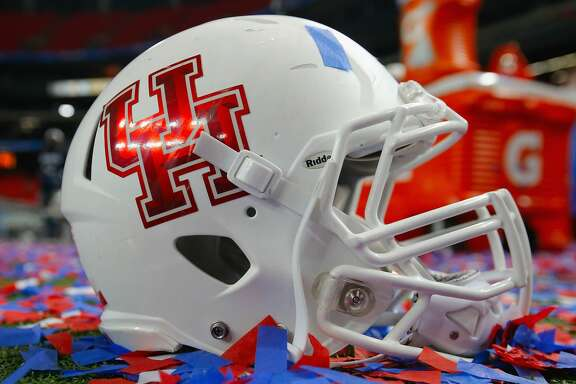 ATLANTA, GA - DECEMBER 31:  A Houston Cougars helmet is surrounded by confetti after the Cougars defeated the Florida State Seminoles 38-24 to win the Chick-fil-A Peach Bowl at the Georgia Dome on December 31, 2015 in Atlanta, Georgia.  (Photo by Kevin C. Cox/Getty Images)