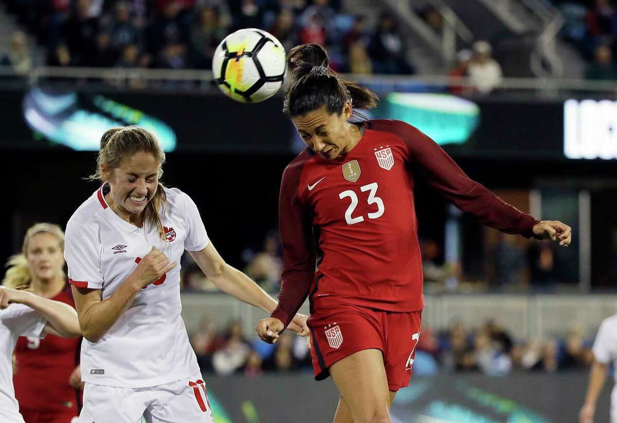 United States forward Christen Press (23) heads the ball as Canada forward Janine Beckie, left, looks on during the first half of an international friendly women's soccer match, Sunday, Nov. 12, 2017, in San Jose, Calif. (AP Photo/Eric Risberg)