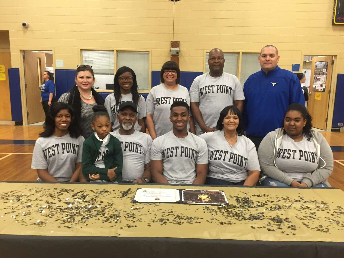 Tyrese White of Hamshire-Fannett signed with the Army Wednesday, February 7, 2018.