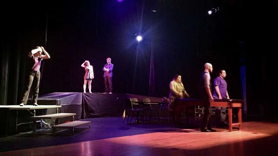The cast of Passion Theatre's production of Next to Normal act out a scene during a dress rehearsal. The show will play at 7:30 p.m. Thursday, Feb. 8, through Saturday, Feb. 10, at Bullock Creek Auditorium. (Photo provided/Passion Theatre)