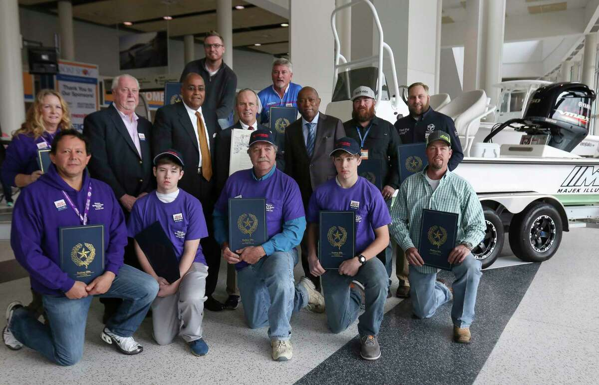 Houston Mayor Sylvester Turner, from third right in second row, Boating Trade Association of Metropolitan Houston President Bob Johnson and Harris County Commissioner Rodney Ellis pose for a photo with Hurricane Harvey Boat Heroes at the 63rd annual Houston International Boat, Sport and Travel Show, also known as Houston Boat Show, at NRG Center on Friday, Jan. 5, 2018, in Houston. Eighteen Boat Heroes who risked their lives or donated their boats to rescue others during the hurricane were recognized at the ceremony but not all of them were able to be there. ( Yi-Chin Lee / Houston Chronicle )